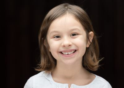 headshot photograph of child