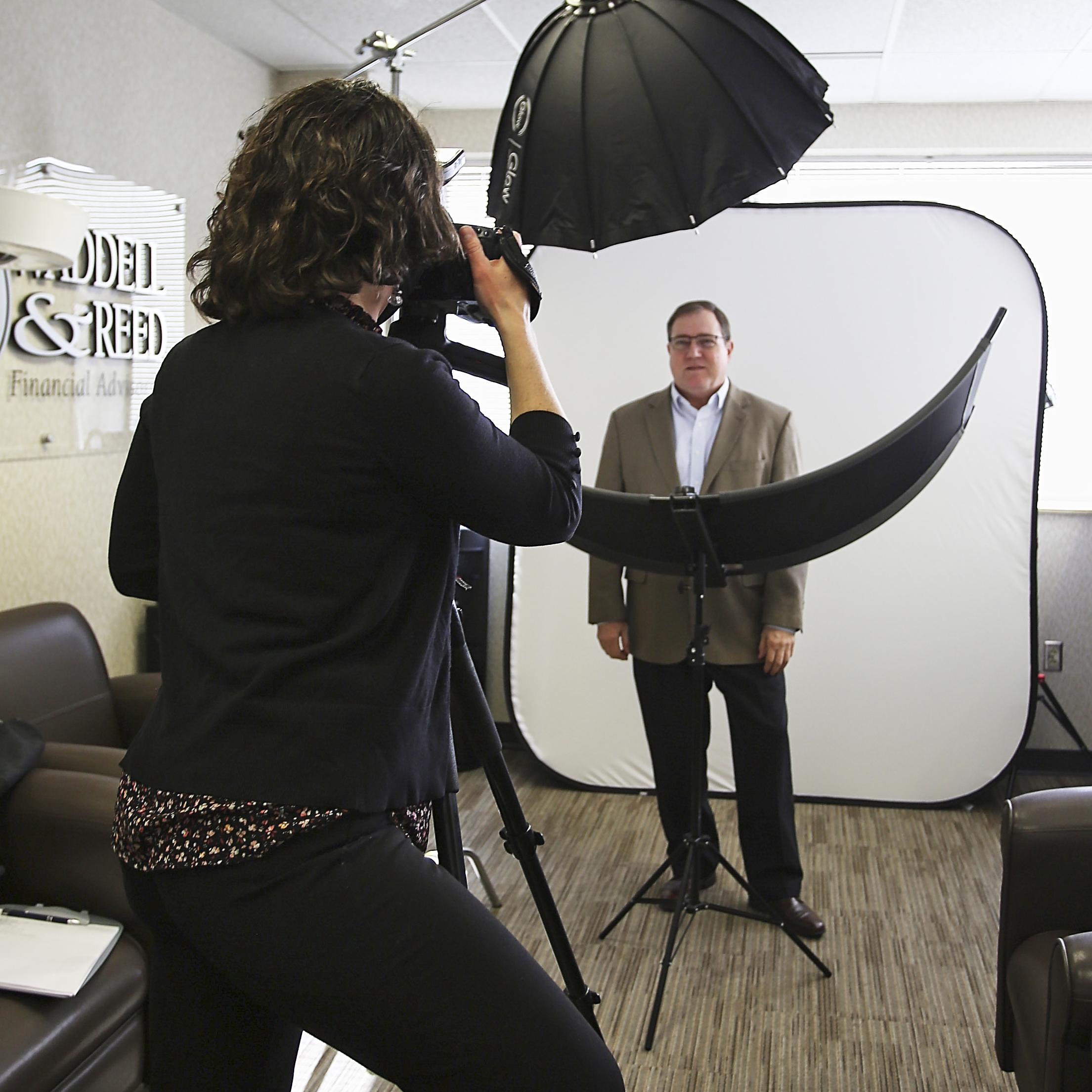on location headshot photographer at work